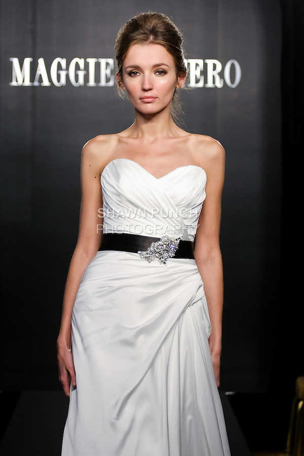 Model walks the runway in a Reba Couture wedding dress from the Maggie Sottero Bridal Spring 2012 collection, during  Couture: New York Bridal Fashion Week 2012