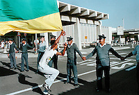 African National Congress (ANC) supporters taunt police at Cape Town airport just before the release of Nelson Mandela from prison.