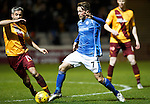 Motherwell v St Johnstone..30.12.15  SPFL  Fir Park, Motherwell<br /> Chris Millar is closed down by Keith Lasley<br /> Picture by Graeme Hart.<br /> Copyright Perthshire Picture Agency<br /> Tel: 01738 623350  Mobile: 07990 594431