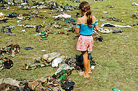 A Colombian girl searching for the army gear after the demobilization ceremony of the AUC paramilitary forces, Meta Department, Colombia, 10 April 2006.