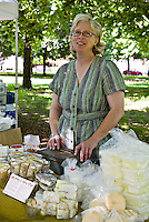 Artisanal cheesemaker, Ruth Klaasen of Monforte Dairy with her hand-made cheese at  the Trinity-Bellwoods farmers' market.