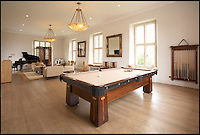 BNPS.co.uk (01202 558833)<br /> Pic: StruttParker/BNPS<br /> <br /> Re-buy my shire...<br /> <br /> Pop star Robbie Williams is so desperate to sell his country mansion home that he is prepared to write off &pound;2.6 million pounds to get rid of it.<br /> <br /> The Take That singer bought sprawling Compton Bassett House in Wiltshire on a whim in 2009 for &pound;8.1 million pounds.<br /> <br /> But shortly after buying it he realised he wanted to return to Los Angeles with his wife, Ayda Field, and tried to sell it in 2010 for &pound;7.5 million pounds.<br /> <br /> But the mansion failed to sell and Robbie has been left with no choice but to lower the asking price for a second time.<br /> <br /> The 70 acre property contains a 7 bedroom mansion, extensive gardens, full sized football pitch, go-cart track, gymnasium, tennis court and a 5-a-side football pitch.