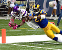 October 11, 2009 - St Louis, Missouri, USA - Viking running back Chester Taylor (29) dives for the pylon as he is hit by Rams safety Oshiomogho Atogwe (21) in the game between the St Louis Rams and the Minnesota Vikings at the Edward Jones Dome.  The Vikings defeated the Rams 38 to 10.  .