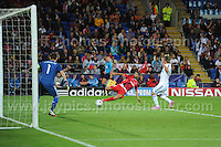 Cardiff City Stadium, Cardiff, South Wales - Tuesday 12th Aug 2014 - UEFA Super Cup Final - Real Madrid v Sevilla - <br /> <br /> Sevilla&rsquo;s Coke and Real Madrid&rsquo;s F&aring;bio Coentr&aring;o in action during the game, as Sevilla&rsquo;s Coke attempts to cross the ball into the centre. <br /> <br /> <br /> <br /> <br /> <br /> Photo by Jeff Thomas/Jeff Thomas Photography