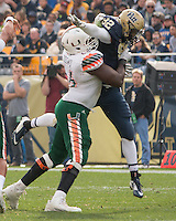 Miami offensive tackle Sunny Odogwu blocks Pitt defensive lineman Rori Blair (92). The Miami Hurricanes football team defeated the Pitt Panthers 29-24 on  Friday, November 27, 2015 at Heinz Field, Pittsburgh, Pennsylvania.