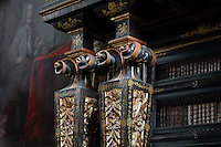 Detail of the scrolled columns on the bookcases with Chinese motifs, lacquer and gilding by Manuel da Silva, in the Black Room of the Joanina Library, or Biblioteca Joanina, a Baroque library built 1717-28 by Gaspar Ferreira, part of the University of Coimbra General Library, in Coimbra, Portugal. The Casa da Livraria was built during the reign of King John V or Joao V, and consists of the Green Room, Red Room and Black Room, with 250,000 books dating from the 16th - 18th centuries. The library is part of the Faculty of Law and the University is housed in the buildings of the Royal Palace of Coimbra. The building is classified as a national monument and UNESCO World Heritage Site. Picture by Manuel Cohen