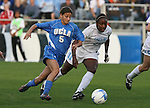1 December 2006: UCLA's Christine DiMartino (5) is chased by North Carolina's Robyn Gayle (CAN) (11). The University of North Carolina Tarheels defeated the University of California Los Angeles Bruins 2-0 at SAS Stadium in Cary, North Carolina in an NCAA Division I Women's College Cup semifinal game.