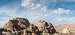 Indian Cove Campground, Joshua Tree National Park, Twenty Nine Palms, California; a panoramic view of the rock formations in late afternoon sunlight, with clouds in the background