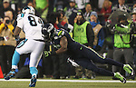 Seattle Seahawks  strong safety Kam Chancellor (31) tackles Carolina Panthers tight end Ed Dickson (84) in the NFC Western Division Playoffs at CenturyLink Field  on January 10, 2015 in Seattle, Washington. The Seahawks beat the Panthers 31-17. ©2015. Jim Bryant Photo. All Rights Reserved.