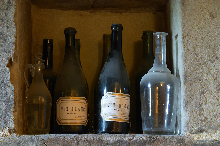 old bottles vin blanc in a niche chateau curson dom pochon crozes hermitage rhone france