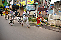 I asked, why some rickshaw pullers work barefooted? I was told because they're used to working barefooted on the farms they come from. But for some, shoes are a luxury.