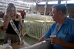 The Iowa Pork Queen and an onlooker, Iowa State Fair, Des Moines, Iowa.