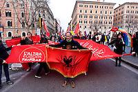 Roma, 14 Febbraio  2015<br /> Manifestazione di solidariet&agrave; con la Grecia di Alexis Tsipras e contro le politiche di austerity imposte dalla troika. Manifestante con la bandiera dell'Albania<br /> Rome, February 14, 2015<br /> Demonstration of solidarity with Greece  of Alexis Tsipras and against austerity policies imposed by the Troika. Protestor with the flag of Albania