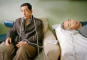 Acupuncture enhanced by electrical pulses intended to cure facial paralysis...Photo taken March 2000