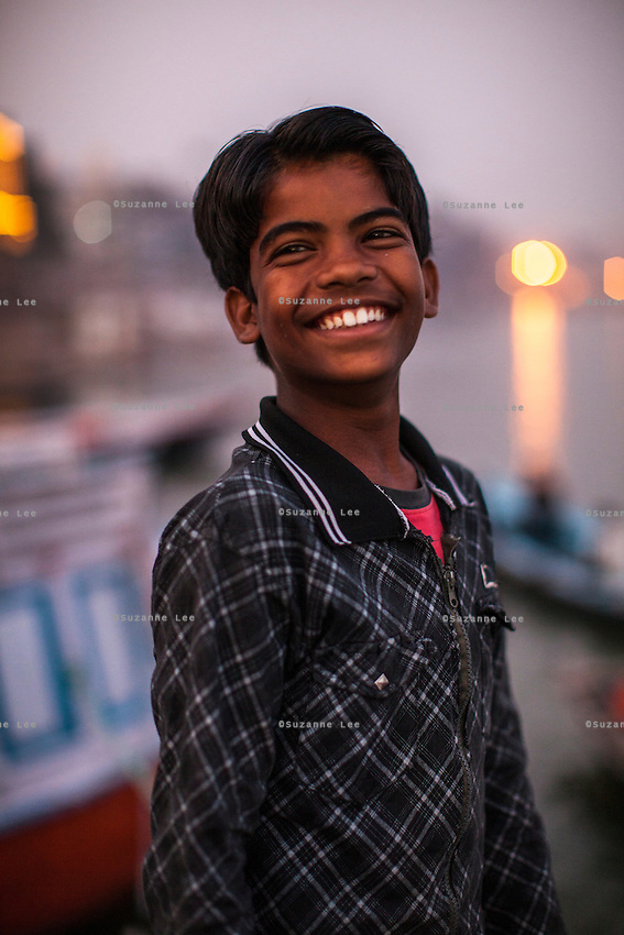 Sachin, 12, poses for a portrait on the Boat School Guria runs on the holy Ganges River, in Varanasi, Uttar Pradesh, India on 19 November 2013. The school, accommodating almost 50 children, aims to take the boatmen's children away from working in the tourist areas where they are exposed to trafficking and sexual abuse.