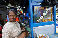 A woman selling Bakso Pangsit, or noddle soup with dumplings, Makassar, Sulawesi, Indonesia.