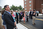 Guests listen to remarks from Athens Mayor  Paul Wiehl at a ribbon cutting ceremony for Bobcat Ln. Photo by Ben Siegel