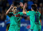 FC Barcelona's Lionel Messi (R) celabrates his first goal with his team mate Andres Iniesta (L) during the Spanish league football match Levante UD vs FC Barcelona on April 14, 2012 at the Ciudad de Valencia Stadium in Valencia. (Photo by Xaume Olleros/Action Plus)