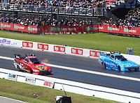 Apr 23, 2017; Baytown, TX, USA; NHRA funny car driver Jonnie Lindberg (left) races alongside Tommy Johnson Jr during the Springnationals at Royal Purple Raceway. Mandatory Credit: Mark J. Rebilas-USA TODAY Sports