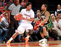 CHARLOTTESVILLE, VA- DECEMBER 6: Jontel Evans #1 of the Virginia Cavaliers handles the ball in front of Corey Edwards #13 of the George Mason Patriots during the game on December 6, 2011 at the John Paul Jones Arena in Charlottesville, Virginia. Virginia defeated George Mason 68-48. (Photo by Andrew Shurtleff/Getty Images) *** Local Caption *** Corey Edwards;Jontel Evans