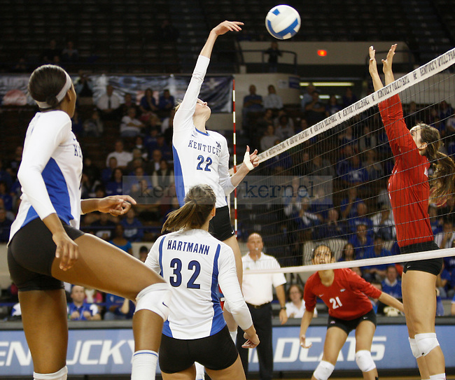 Becky Pavan of the UK Women's Volleyball team spikes the ball against Arkansas on 11/20/11 in Lexington, Ky. Photo by Quianna Lige | Staff