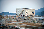 A building lies removed from its foundations after the mega-tsunami in Minami-Sanriku, a coastal town in Miyagi Prefecture, Japan on 14 March, 2011. Around 10,00 of the town's 17,000 population are reported as either dead or missing. Photographer: Robert Gilhooly
