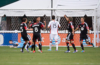 Luis Silva (12) of D.C. United celebrates his goal with teammate John Thorrington (8) and others during a Major League Soccer game at RFK Stadium in Washington, DC.  New England defeated D.C. United, 2-1.