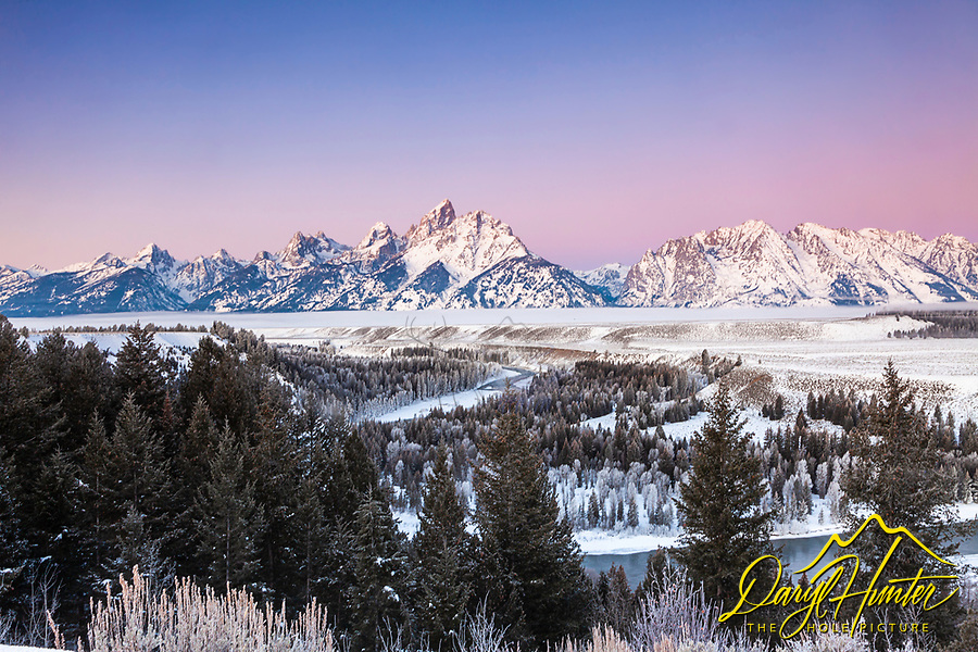 Winter sunrise at the Snake River Overlook in Grand Teton National Park. A crisp -8 degree morning made this morning glow.