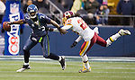 Seattle Seahawks quarterback Tarvaris Jackson tries to scramble away from Washington Redskins Kevin Barnes in the fourth quarter at  CenturyLink Field in Seattle, Washington on November 27, 2011. Jackson completed 14 of 30 passes for 144 yards, two touchdowns and had one intercepted as the Redskins stunned the Seattle Seahawks 23-17. ©2011 Jim Bryant Photo. All Rights Reserved.