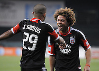 D.C. United forward Maicon Santos (29) celebrates with teammate Nick DeLeon (18)  his second goal of the game in the 73th minute of the game. D.C. United defeated FC Dallas 4-1 at RFK Stadium, Friday March 30, 2012.