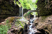 Waterfall under one of the stone bridges deep inside the gorge at Watkins Glen, a New York state park.