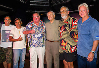 """HONOLULU, Turtle Bay Resort, North Shore, Oahu. - (Thursday, January 3, 2013) Garrett McNamara (HAW), Reno Abellira (HAW), Greg Noll (HAW), Peter Cole (USA) Kimo Hollinger (HAW) and Randy Rarick (HAW).   Greg Noll (USA) was the guest  speaker of Talk Story at Surfer The Bar tonight, Noll, nicknamed """"Da Bull"""" by Phil Edwards in reference to his physique and way of """"charging"""" down the face of a wave is an American pioneer of big wave surfing and is also acknowledged as a prominent longboard shaper. Noll was a member of a US lifeguard team that introduced Malibu boards to Australia around the time of the Melbourne Olympic Games. Noll became known for his exploits in large Hawaiian surf on the North Shore of Oahu. He first gained a reputation in November 1957 after surfing Waimea Bay in 25-30 ft surf when it had previously been thought impossible even to the local Hawaiians. He is perhaps best known for being the first surfer to ride a wave breaking on the outside reef at the so-called Banzai Pipeline in November 1964...It was later at Makaha, in December 1969, that he rode what many at the time believed to be the largest wave ever surfed. After that wave and the ensuing wipeout during the course of that spectacular ride down the face of a massive dark wall of water, his surfing tapered off and he closed his Hermosa Beach shop in the early 1970s. He and other surfers such as Pat Curren, Mike Stang, Buzzy Trent, George Downing, Mickey Munoz, Wally Froyseth, Fred Van Dyke and Peter Cole are viewed as the most daring surfers of their generation...Noll is readily identified in film footage while surfing by his now iconic black and white horizontally striped """"jailhouse"""" boardshorts and was interviewed by host Jodi Wilmott (AUS). . Photo: joliphotos.com"""