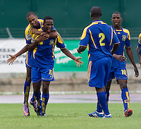 Akeem Maloney (16) of Barbados celebrates a goal with his teammates during the group stage of the CONCACAF Men's Under 17 Championship at Catherine Hall Stadium in Montego Bay, Jamaica. Honduras defeated Barbados, 2-1.