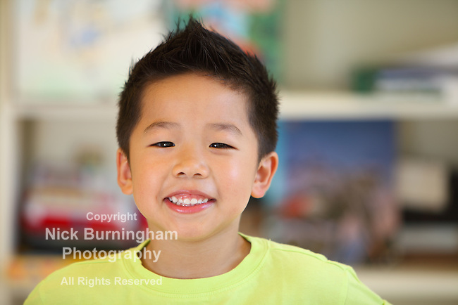 Happy smiling young Asian boy