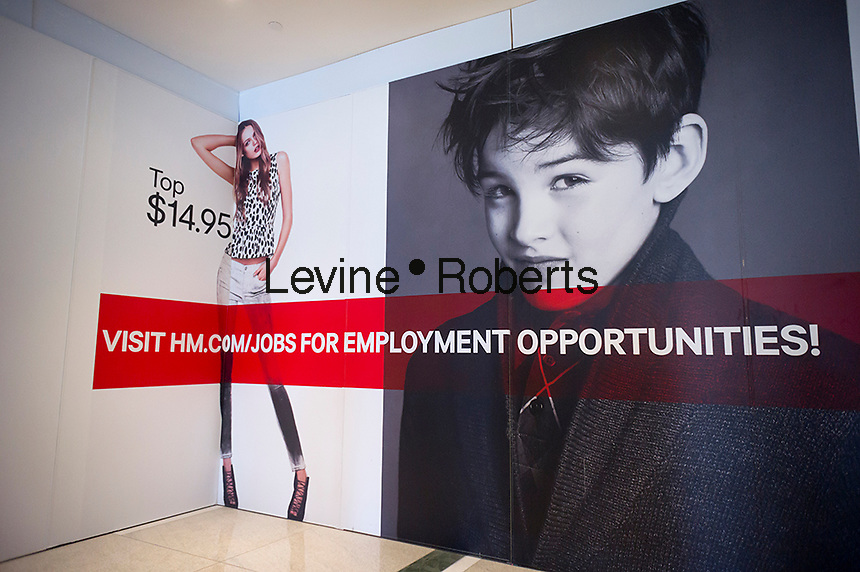 A sign outside the future home of an H&M department store in the Time Warner Center in New York is seen on Saturday, September 22, 2012. (© Richard B. Levine)