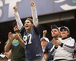 A Seattle Seahawks fan cheers against the Atlanta Falcons at CenturyLink Field in Seattle, Washington on October 2, 2011. The Falcons beat the Seahawks 30-28 . ©2011 Jim Bryant Photo. All Rights Reserved.
