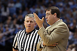 27 December 2014: UAB head coach Jerod Haase (right) complains to referee Bryan Kersey (left). The University of North Carolina Tar Heels played the University of Alabama Birmingham Blazers in an NCAA Division I Men's basketball game at the Dean E. Smith Center in Chapel Hill, North Carolina. UNC won the game 89-58.