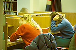 Teen aged students in library