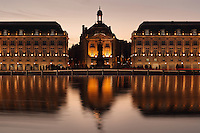 Place de la Bourse (Stock Exchange Square) or Place Royale, built 1730-55 by architect Ange-Jacques Gabriel during the reign of King Louis XV, Bordeaux, Aquitaine, France. The royal square is a symmetrical rectangular space with the Stock Exchange to the North, Farms Hall to the East, a central building to the West and the Garonne River to the South. The buildings are reflected in the Miroir d'Eau, a 130x42m reflecting pool by Michel Corajoud and J M Llorca, inaugurated in 2006. The square forms part of the Port of the Moon and is listed as a UNESCO World Heritage Site, and the buildings are listed as historic monuments. Picture by Manuel Cohen