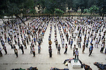 Students gather in the Dong Da primary school exercise yard before attending classes in Hanoi, North Vietnam.  (Jim Bryant Photo).....