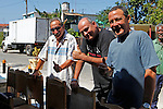 Central America, Cuba, Havana. Men of Muralenado Community Project enjoying live music.