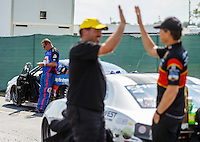 Sep 5, 2016; Clermont, IN, USA; NHRA pro stock driver Allen Johnson (left) reacts as Chris McGaha celebrates after winning the US Nationals at Lucas Oil Raceway. Mandatory Credit: Mark J. Rebilas-USA TODAY Sports