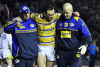 PICTURE BY VAUGHN RIDLEY/SWPIX.COM - Rugby League - Gillette World Club Challenge 2010 - Leeds Rhinos v Melbourne Storm - Elland Road, Leeds, England  - 28/02/10...Copyright - Simon Wilkinson - 07811267706...Leeds Rhinos Kevin Sinfield injures his leg.