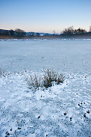 Frozen winter shorline of Llangorse lake, Brecon Beacons national park, Wales