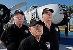 Salvador Miralles, front, and Esteban Bovo, right  piloted a B-26 bomber like the one seen here at Kendall-Tamiami Executive Airport during the Bay of Pigs invasion of Cuba. Julio Rebull, left, was a gunner on the bomber. They are members of the Bay of Pigs Veterans Association, Brigade 2506.