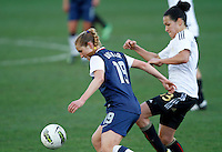 US's Rachel Buehler fights for the ball with Germany's Celia Okoyino Da Mbabi during their Algarve Women's Cup soccer match at Algarve stadium in Faro, March 13, 2013.  .Paulo Cordeiro/ISI