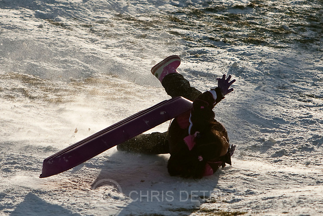 Chris Detrick  |  The Salt Lake Tribune .A young sledder wipes out Sugarhouse Park Friday November 26, 2010.