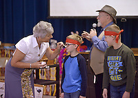NWA Democrat-Gazette/BEN GOFF @NWABENGOFF<br /> Nellie Beggs of Sydney, Australia paints Xavier Mann's face as fellow 4th grader Drew Cable looks on as the students join in an Aboriginal dance for boys Monday, Feb. 13, 2017, during a presentation at R.E. Baker Elementary in Bentonville. Husband and wife Martin and Nellie Beggs have been presenting their 'Australian Kaleidoscope' program at schools in the United States for over ten years for the Kansas City, Mo. company 'The Cultural Kaleidoscope'. Students joined in songs and Aboriginal dances as they learned about the natural and cultural history of 'The Land Down Under' in assemblies and classes throughout the day.