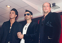 """Moenia pop music band members, Alejandro Ortega (L), Jorge Soto and Alfonso Pichardo (R) pose to photographers as they arrive at a press conference, March 28, 2006. Moenia received  a golden award after selling 50 thousand copies of their last CD """"Hits Live"""". Photo by © Javier Rodriguez"""
