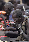 Thiet feeding camp in Southern Sudan. Hundreds of Dinka tribes people having had their villages bombed and burnt  by the Khartoum forces  have travelled hundreds of miles to  avoid  starvation a the feeding centre.